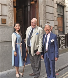Ms Yuri, Michael Sefi LVO RDP FRPSL, former Keeper of the Royal Philatelic Collection, and Jack Zhang FRPSL look excited before stepping in.
